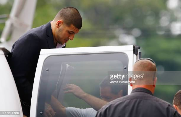 Aaron Hernandez is escorted into Attleboro District Court prior to his hearing on August 22 2013 in North Attleboro Massachusetts Former New England...
