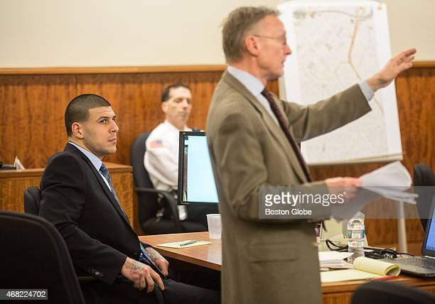 Aaron Hernandez left listens at his attorney Charles Rankin questions a witness during the murder trial of former New England Patriots tight end at...