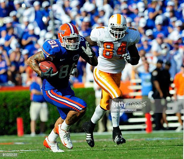 Aaron Hernandez of the Florida Gators is chased by Chris Walker of the Tennessee Volunteers during the game at Ben Hill Griffin Stadium on September...