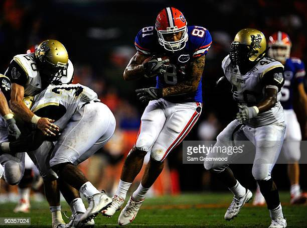 Aaron Hernandez of the Florida Gators runs for yardage during the game against the Charleston Southern Buccaneers at Ben Hill Griffin Stadium on...