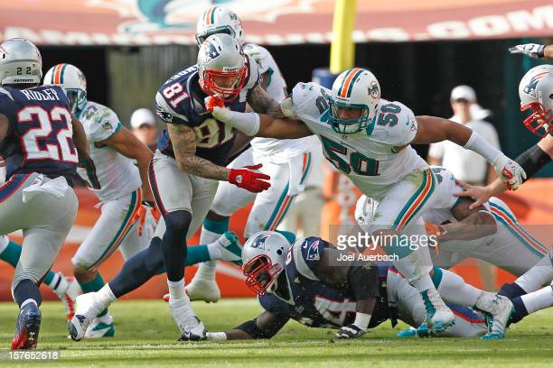Aaron Hernandez of the New England Patriots and Olivier Vernon of the Miami Dolphins battle along the line on December 2 2012 at Sun Life Stadium in...
