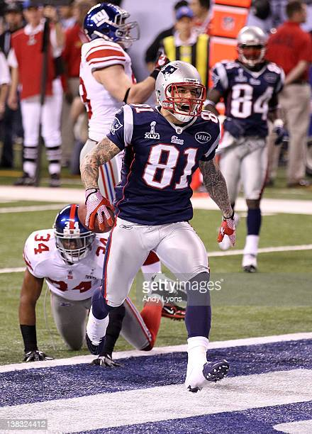 Aaron Hernandez of the New England Patriots celebrates after catching a 12 yard touchdown pass from Tom Brady in the third quarter against Deon Grant...