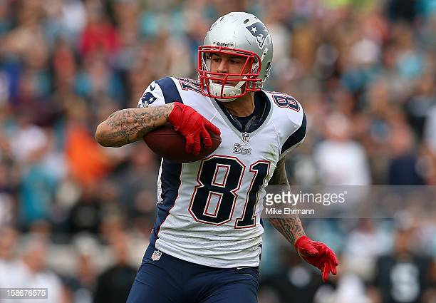 Aaron Hernandez of the New England Patriots makes a catch during a game against the Jacksonville Jaguars at EverBank Field on December 23 2012 in...
