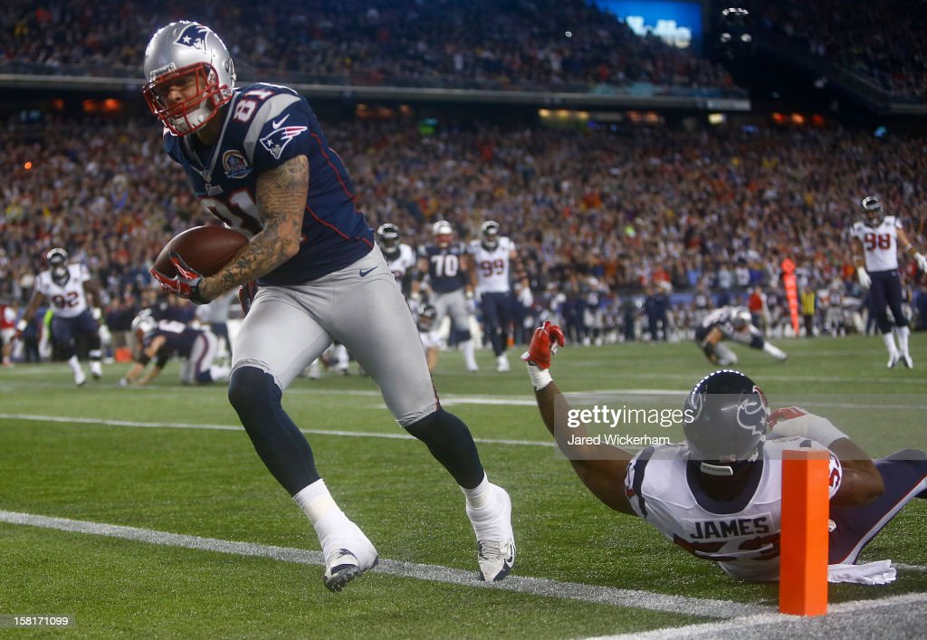 <a gi-track='captionPersonalityLinkClicked' href=/galleries/search?phrase=Aaron+Hernandez+-+American+Football+Player&family=editorial&specificpeople=4586516 ng-click='$event.stopPropagation()'>Aaron Hernandez</a> #81 of the New England Patriots runs in for the touchdown after catching a pass in front of <a gi-track='captionPersonalityLinkClicked' href=/galleries/search?phrase=Bradie+James&family=editorial&specificpeople=756554 ng-click='$event.stopPropagation()'>Bradie James</a> #53 of the Houston Texans during the game at Gillette Stadium on December 10, 2012 in Foxboro, Massachusetts.