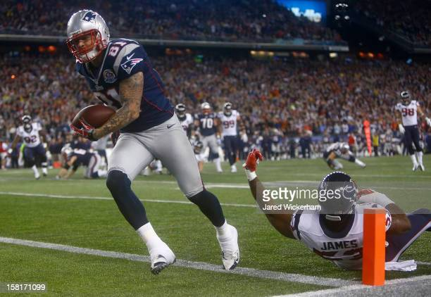 Aaron Hernandez of the New England Patriots runs in for the touchdown after catching a pass in front of Bradie James of the Houston Texans during the...