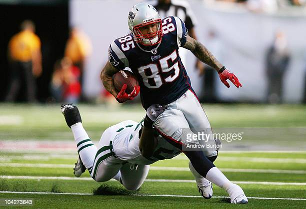 Aaron Hernandez of the New England Patriots runs through a tackle from David Harris of the New York Jets during the first quarter at the New...