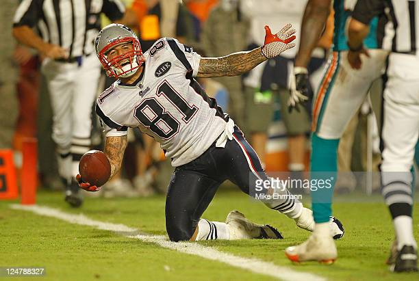Aaron Hernandez of the New England Patriots scores a touchdown during a game against the Miami Dolphins at Sun Life Stadium on September 12 2011 in...