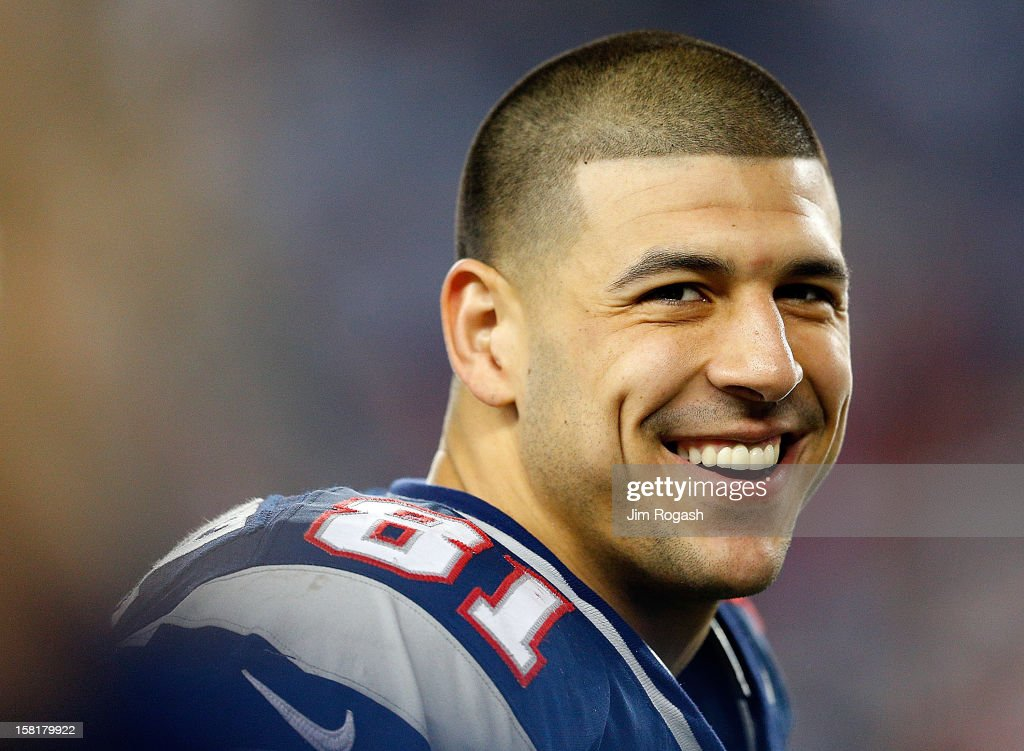 Aaron Hernandez #81 of the New England Patriots smiles from the sidelines in the fourth quarter during a game against the Houston Texans at Gillette Stadium on December 10, 2012 in Foxboro, Massachusetts.
