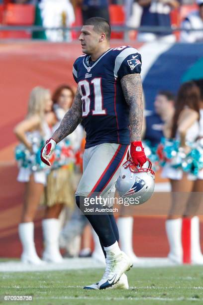 Aaron Hernandez of the New England Patriots walks off the field during the fourth quarter against the Miami Dolphins on December 2 2012 at Sun Life...