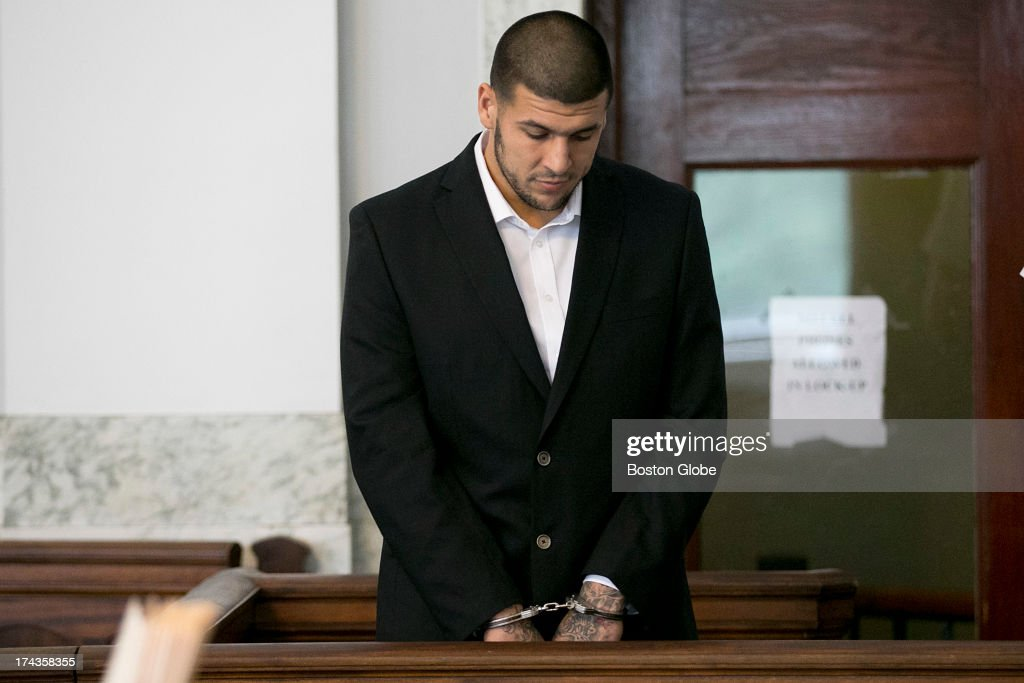 Aaron Hernandez stood in the court room. Former New England Patriots tight end Aaron Hernandez appeared in Attleboro District Court in Attleboro, Mass. on Wednesday, July 24, 2013.