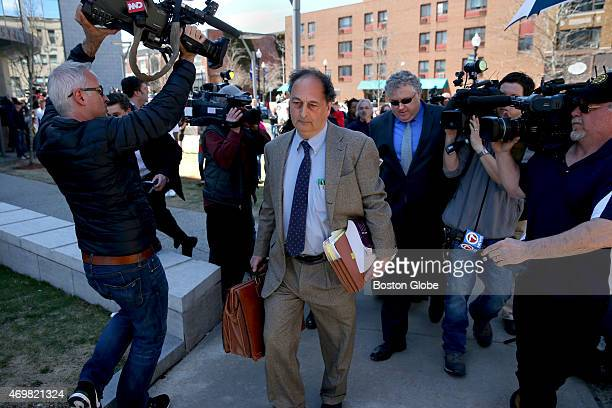 Aaron Hernandez's defense attorneys James Sultan front and Michael Fee rear left court without taking questions after their client was convicted of...