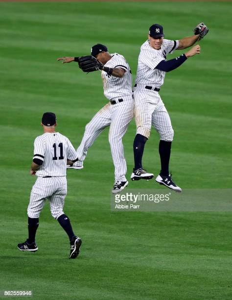 Aaron Hicks and Aaron Judge of the New York Yankees celebrate after defeating the Houston Astros in Game Four of the American League Championship...