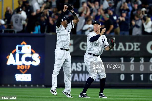 Aaron Hicks and Aaron Judge of the New York Yankees celebrate after defeating the Houston Astros in Game Five of the American League Championship...