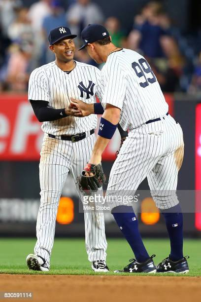Aaron Hicks and Aaron Judge of the New York Yankees celebrates after defeating the Boston Red Sox 54 at Yankee Stadium on August 11 2017 in the Bronx...