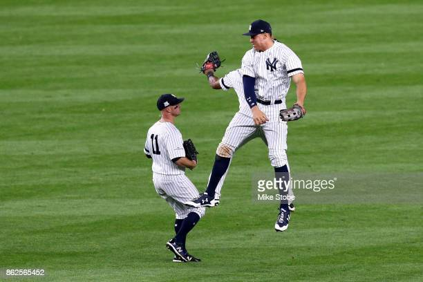 Aaron Hicks Brett Gardner and Aaron Judge of the New York Yankees celebrate after defeating the Houston Astros in Game Four of the American League...