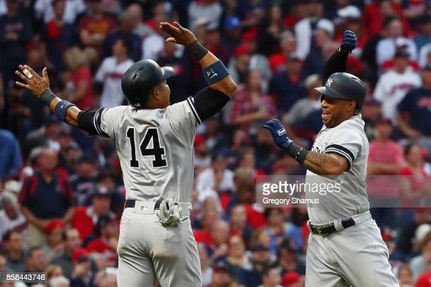 Aaron Hicks celebrates his threerun home run with Starlin Castro of the New York Yankees in the against the Cleveland Indians third inning during...
