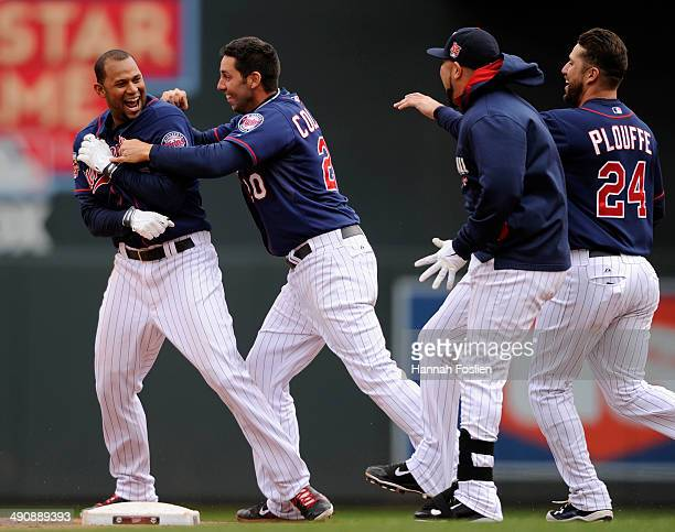 Aaron Hicks Chris Colabello Josmil Pinto and Trevor Plouffe of the Minnesota Twins celebrate a walkoff single by Hicks against the Boston Red Sox...