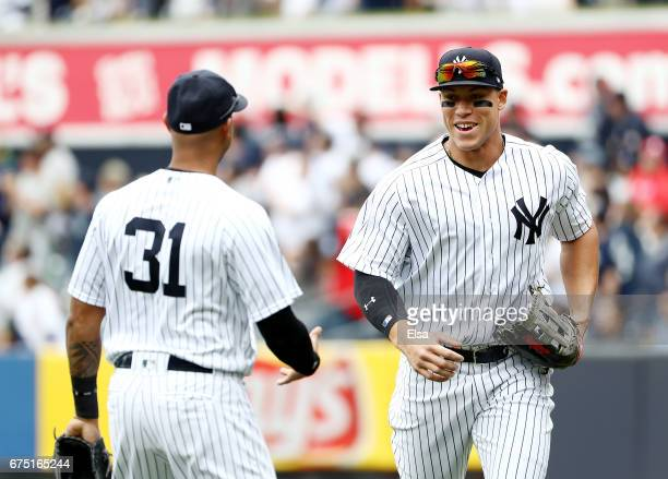 Aaron Hicks congratulates Aaron Judge of the New York Yankees for making the catch for the final out of the first inning against the Baltimore...