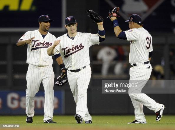 Aaron Hicks Josh Willingham and Oswaldo Arcia of the Minnesota Twins celebrate a win of the game against the Milwaukee Brewers on June 4 2014 at...
