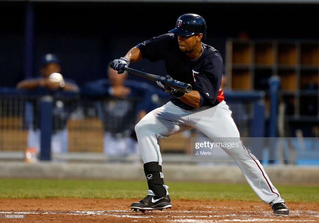 Aaron Hicks #63 of the Minnesota Twins attempts a bunt against the Tampa Bay Rays during a Grapefruit League spring training game at the Charlotte Sports Complex on March 11, 2013 in Port Charlotte, Florida.