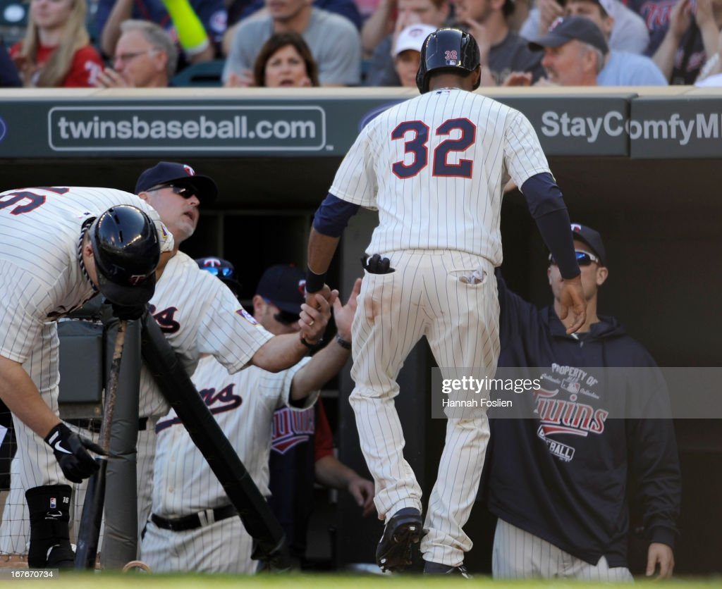 Aaron Hicks #32 of the Minnesota Twins celebrates scoring a run against the Texas Rangers during the third inning of the game on April 27, 2013 at Target Field in Minneapolis, Minnesota.