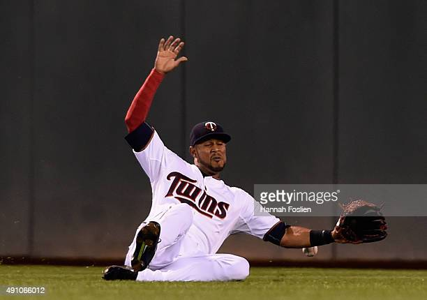 Aaron Hicks of the Minnesota Twins is unable catch a double off the bat of Jarrod Dyson of the Kansas City Royals in center field during the fifth...
