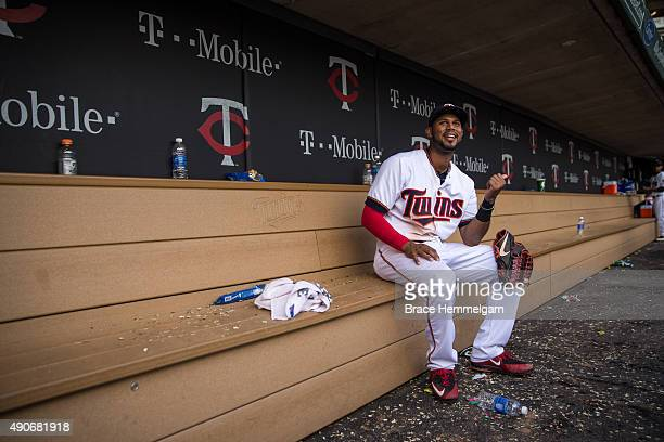 Aaron Hicks of the Minnesota Twins looks on from the dugout following the game against the Los Angeles Angels on September 20 2015 at Target Field in...