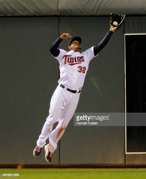 Aaron Hicks of the Minnesota Twins makes a catch in center field of the ball hit by Mike Zunino of the Seattle Mariners during the eighth inning of...