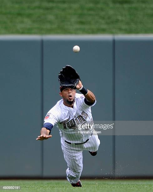 Aaron Hicks of the Minnesota Twins makes a catch of the ball hit by Leonys Martin of the Texas Rangers in center field during the fifth inning of the...