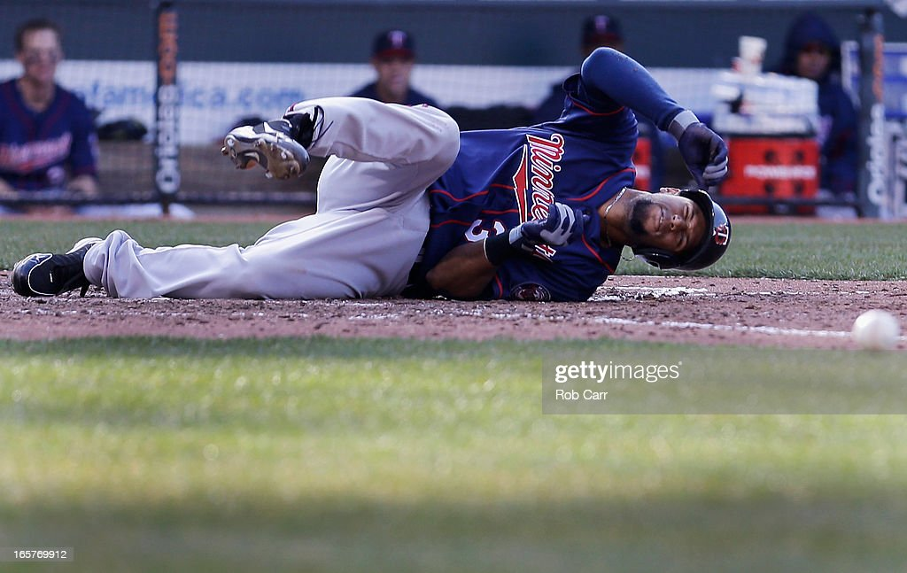 Aaron Hicks #32 of the Minnesota Twins reacts after fouling off a pitch on his foot during the sixth inning against the Baltimore Orioles during opening day at Oriole Park at Camden Yards on April 5, 2013 in Baltimore, Maryland.