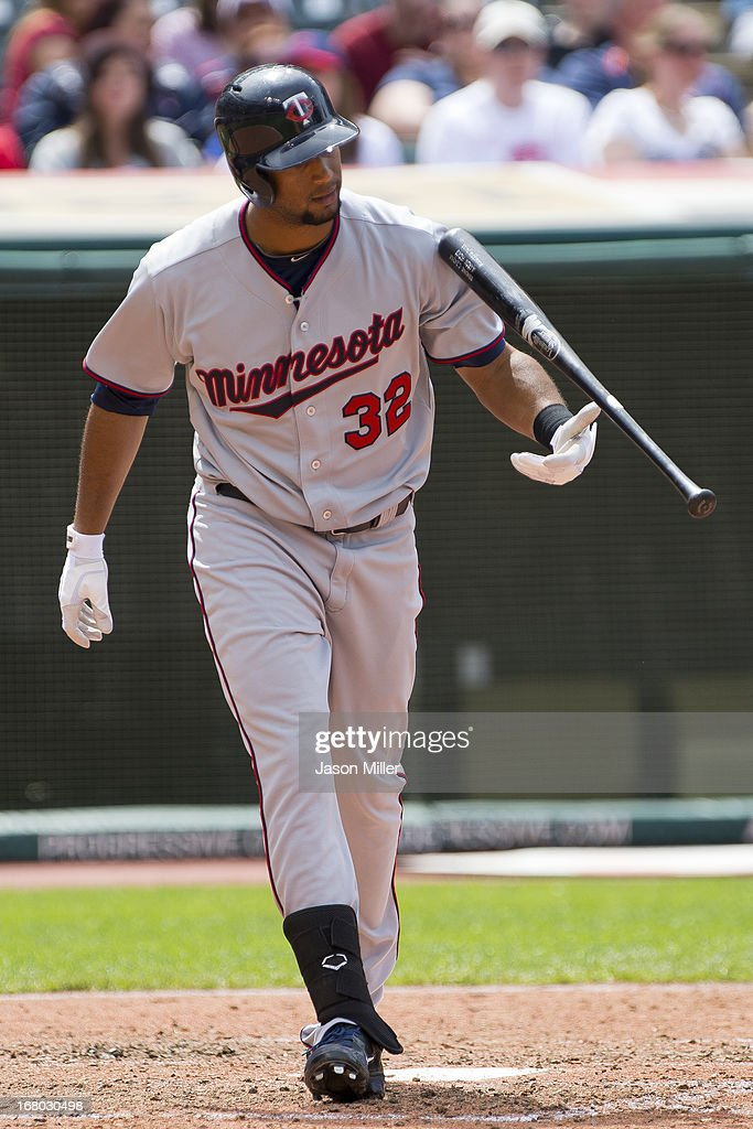 Aaron Hicks #32 of the Minnesota Twins reacts to striking out during the seventh inning against the Cleveland Indians at Progressive Field on May 4, 2013 in Cleveland, Ohio.