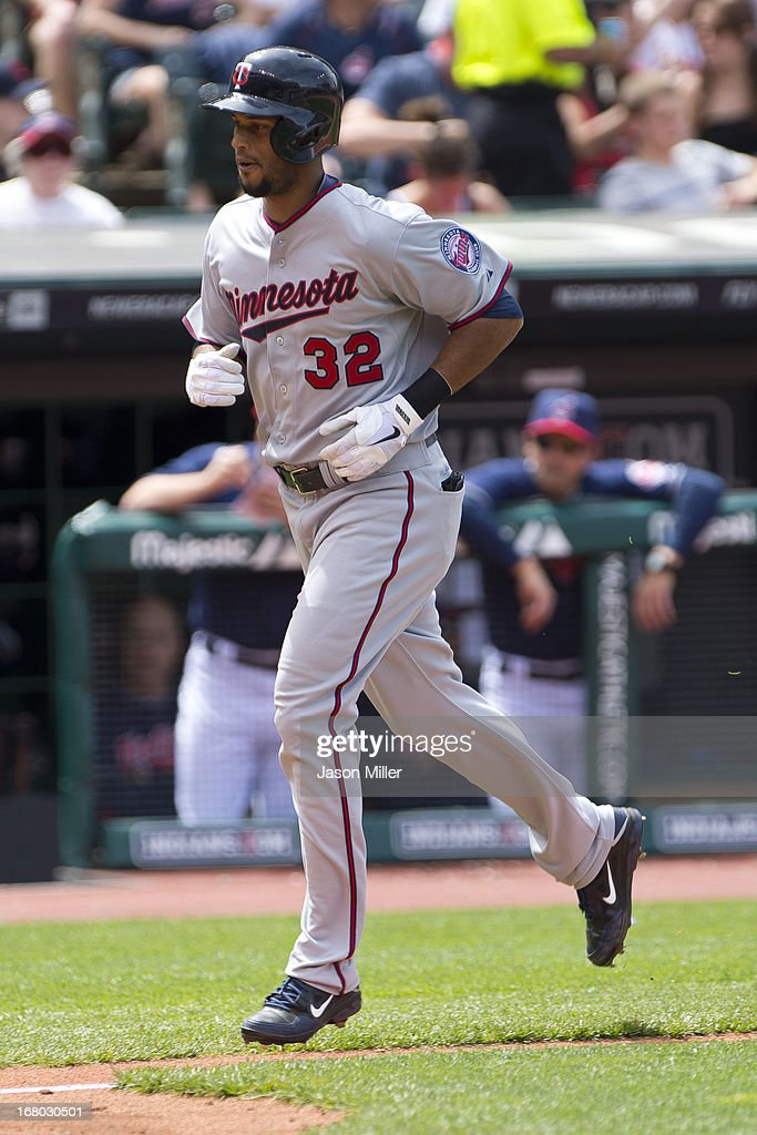 <a gi-track='captionPersonalityLinkClicked' href=/galleries/search?phrase=Aaron+Hicks&family=editorial&specificpeople=5471630 ng-click='$event.stopPropagation()'>Aaron Hicks</a> #32 of the Minnesota Twins rounds the bases after hitting a solo home run during the fifth inning against the Cleveland Indians at Progressive Field on May 4, 2013 in Cleveland, Ohio.