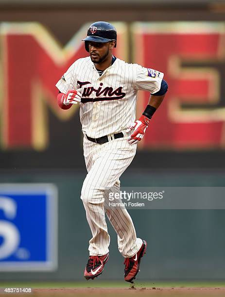 Aaron Hicks of the Minnesota Twins rounds the bases after hitting a solo home run against the Texas Rangers during the first inning of the game on...