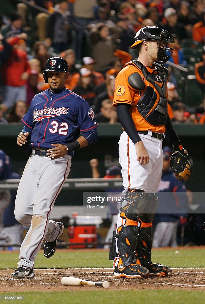 Aaron Hicks #32 of the Minnesota Twins scores the go ahead run in front of catcher <a gi-track='captionPersonalityLinkClicked' href=/galleries/search?phrase=Matt+Wieters&family=editorial&specificpeople=4498276 ng-click='$event.stopPropagation()'>Matt Wieters</a> #32 of the Baltimore Orioles during the ninth inning of the Twins 6-5 win at Oriole Park at Camden Yards on April 6, 2013 in Baltimore, Maryland.