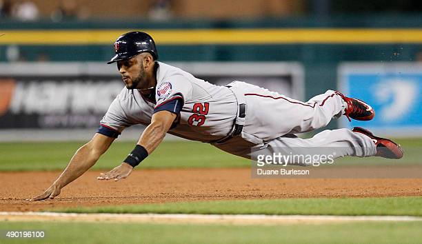 Aaron Hicks of the Minnesota Twins steals third base against the Detroit Tigers during the seventh inning at Comerica Park on September 26 2015 in...