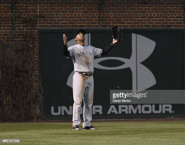 Aaron Hicks of the New York Yankees can't find a home run ball hit by Javier Baez of the Chicago Cubs during the third inning on May 7 2017 at...