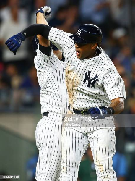 Aaron Hicks of the New York Yankees celebrates after hitting a 2run home run in the eighth inning against the Boston Red Sox at Yankee Stadium on...