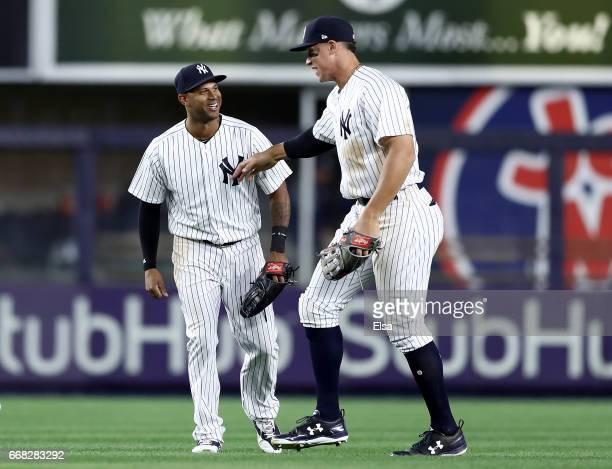 Aaron Hicks of the New York Yankees celebrates the 32 over the Tampa Bay Rays with teammate Aaron Judge on April 13 2017 at Yankee Stadium in the...