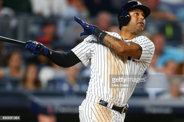 Aaron Hicks of the New York Yankees connects on a 2run home run in the eighth inning against the Boston Red Sox at Yankee Stadium on August 11 2017...