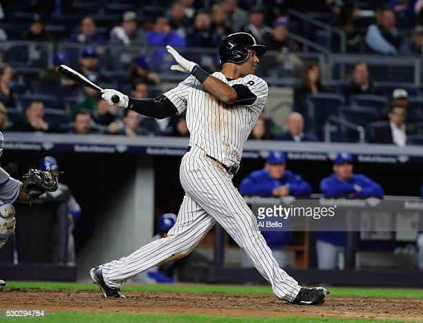 Aaron Hicks of the New York Yankees drives in a run with a double in the seventh inning against the Kansas City Royals during their game at Yankee...
