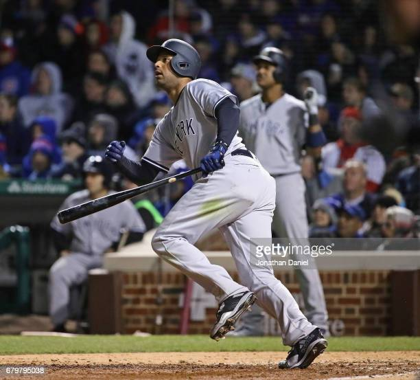 Aaron Hicks of the New York Yankees follows the flight of his three run home run in the 8th inning against the Chicago Cubs at Wrigley Field on May 6...