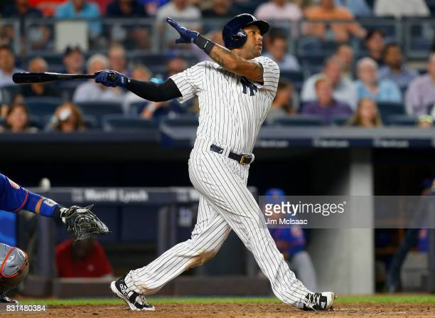 Aaron Hicks of the New York Yankees follows through on an eighth inning home run against the New York Mets at Yankee Stadium on August 14 2017 in the...