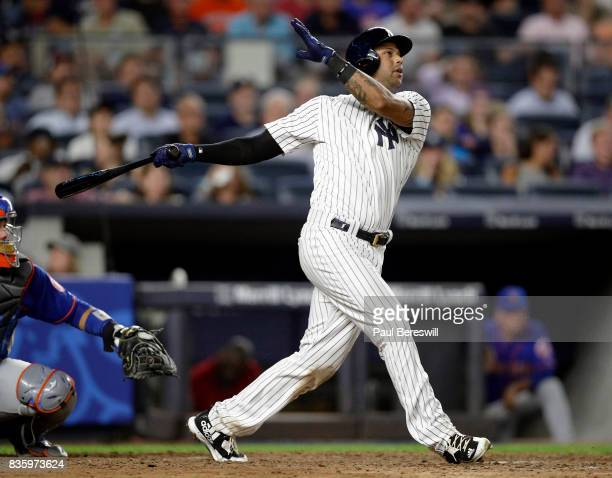 Aaron Hicks of the New York Yankees hits a home run in an MLB baseball game against the New York Mets on August 14 2017 at Yankee Stadium in the...
