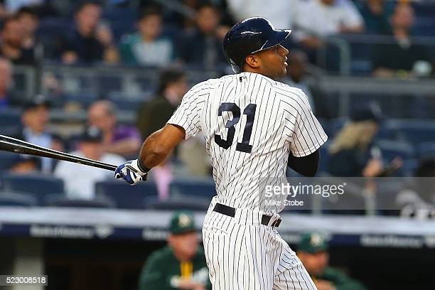 Aaron Hicks of the New York Yankees hits a RBI single in the second inning against the Oakland Athletics at Yankee Stadium on April 21 2016 in the...