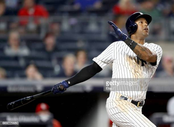 Aaron Hicks of the New York Yankees hits a solo home run in the fifth inning against the St Louis Cardinals on April 16 2017 at Yankee Stadium in the...