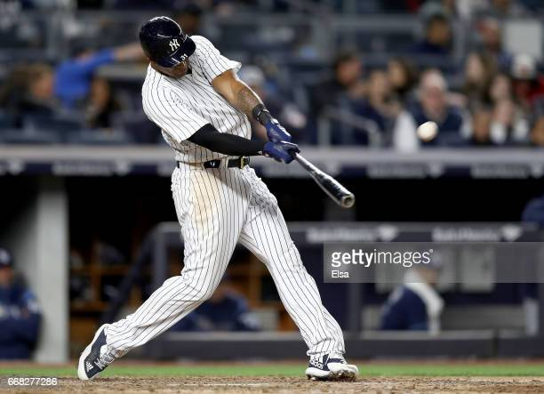 Aaron Hicks of the New York Yankees hits a two run home run in the seventh inning against the Tampa Bay Rays on April 13 2017 at Yankee Stadium in...