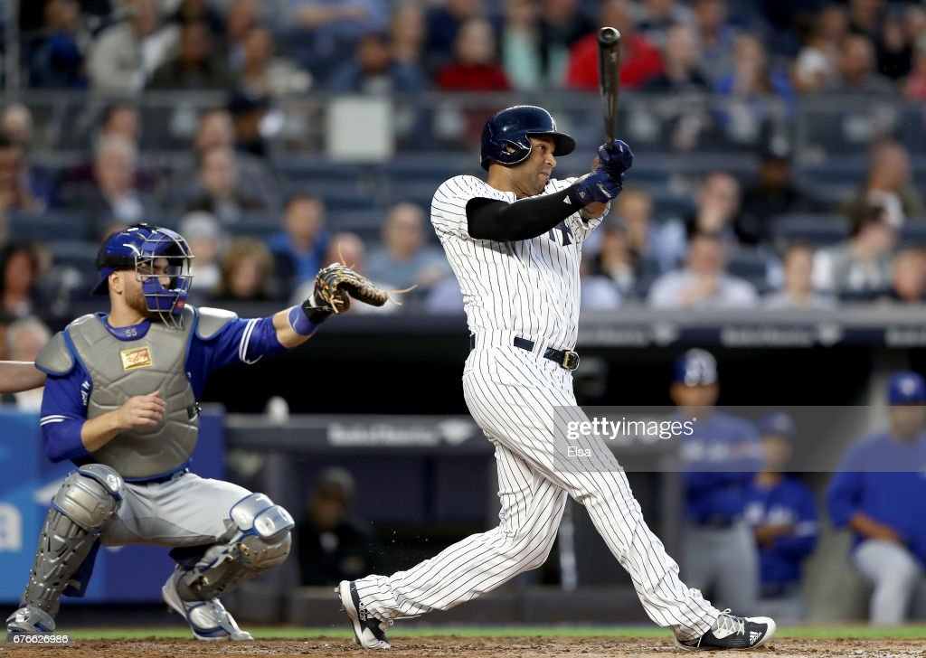 Aaron Hicks #31 of the New York Yankees hits a two run home run in the second inning as Russell Martin #55 of the Toronto Blue Jays defends on May 2, 2017 at Yankee Stadium in the Bronx borough of New York City.