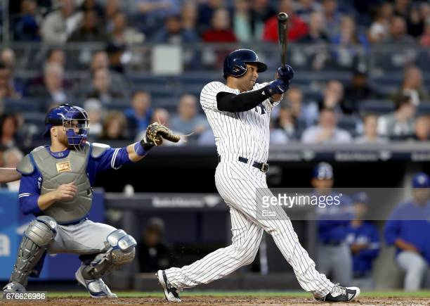 Aaron Hicks of the New York Yankees hits a two run home run in the second inning as Russell Martin of the Toronto Blue Jays defends on May 2 2017 at...