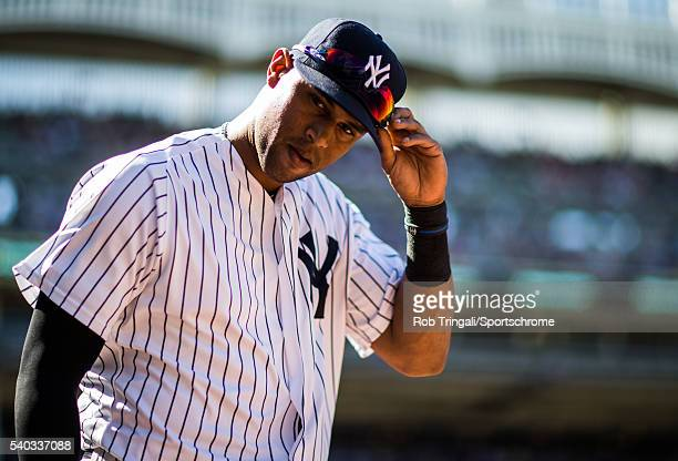 Aaron Hicks of the New York Yankees looks on during the game against the Detroit Tigers at Yankee Stadium on June 12 2016 in the Bronx borough of New...