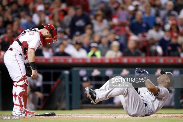 Aaron Hicks of the New York Yankees reacts after being hit by a pitch in the seventh inning of a game against the Cincinnati Reds at Great American...